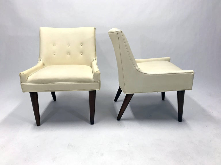 A pair of Mid-Century slipper chairs in the manner of Milo Baughman, a la his Model 176 chair produced by Thayer Coggin in the late 1950s.