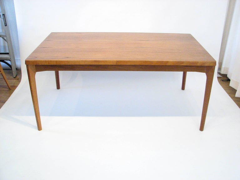Danish teak dining table with pull-out extension leaves by Henning Kjærnulf for Vejle Stole & Møbelfabrik, 1960s.  Leaves are in pristine condition.  Each leaf adds 21.5 in. in length.  Please Note:  Pickup for this table is in Denver,