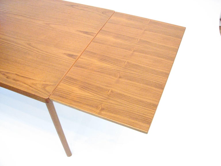Midcentury Danish Teak Dining Table with Pull-Out Leaves by Henning Kjærnulf In Good Condition For Sale In Portland, OR