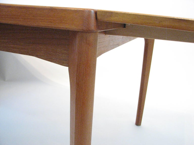 Midcentury Danish Teak Dining Table with Pull-Out Leaves by Henning Kjærnulf For Sale 2