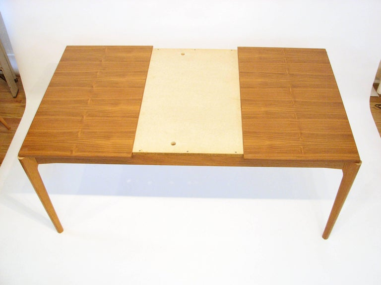 Scandinavian Modern Midcentury Danish Teak Dining Table with Pull-Out Leaves by Henning Kjærnulf For Sale
