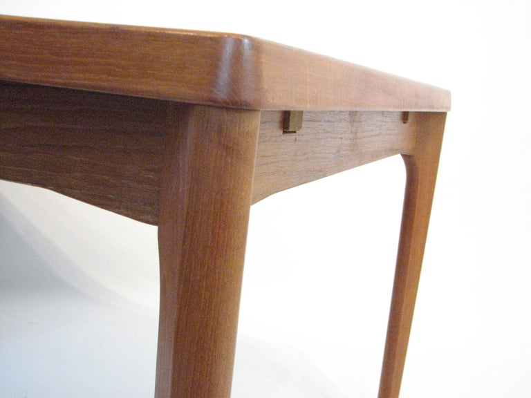Midcentury Danish Teak Dining Table with Pull-Out Leaves by Henning Kjærnulf For Sale 1