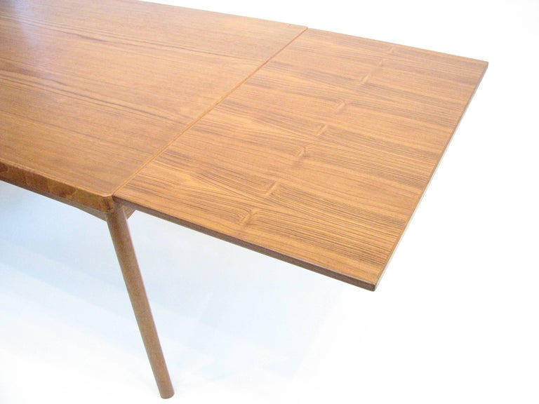 Mid-20th Century Midcentury Danish Teak Dining Table with Pull-Out Leaves by Henning Kjærnulf For Sale