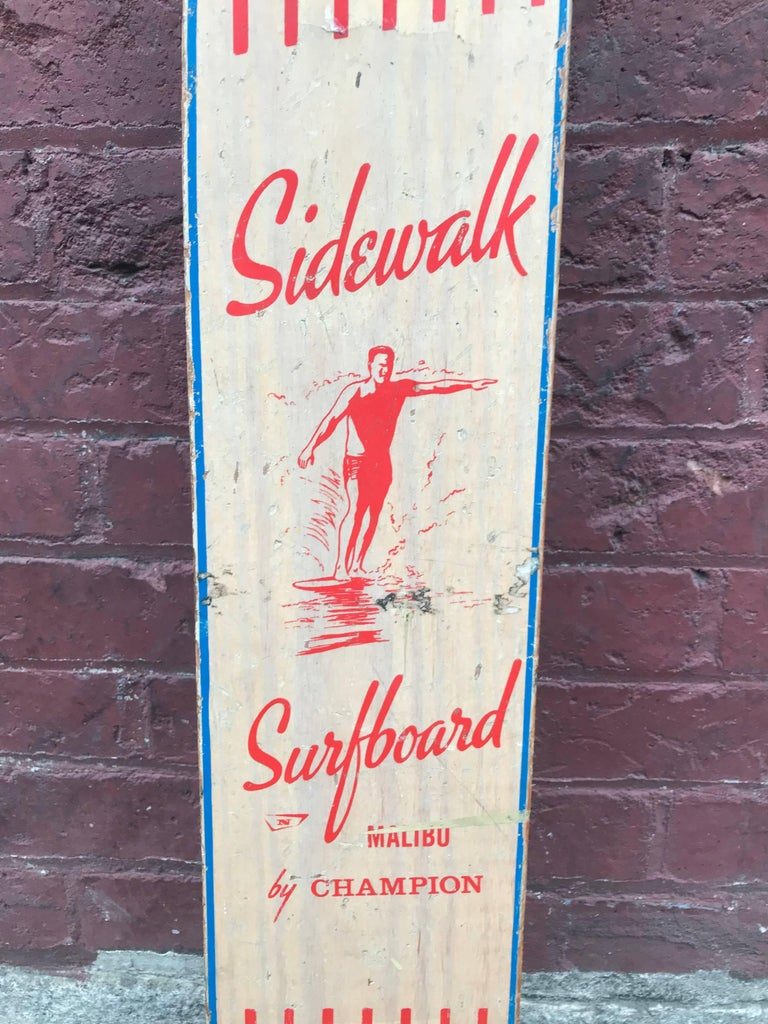 A wonderful example of a skateboard deck by Champion called the Sidewalk Surfboard Malibu with a surf dude hanging 10 on the nose.