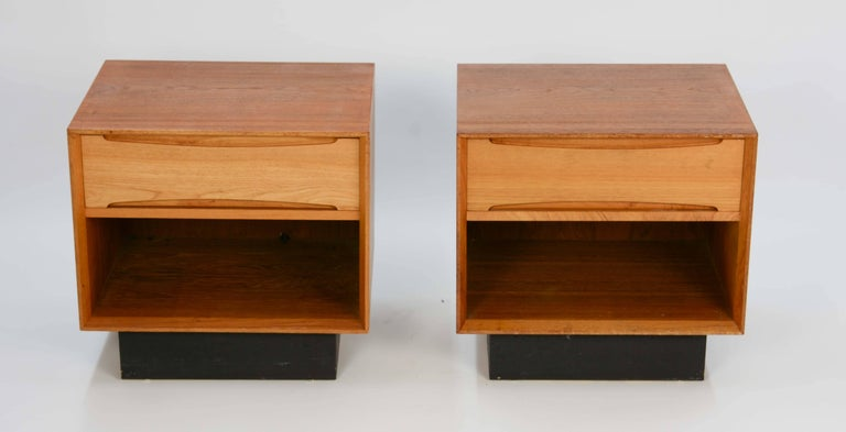 A wonderful pair of Drylund nightstands from Denmark. They are free floating pieces because the backs are finished.