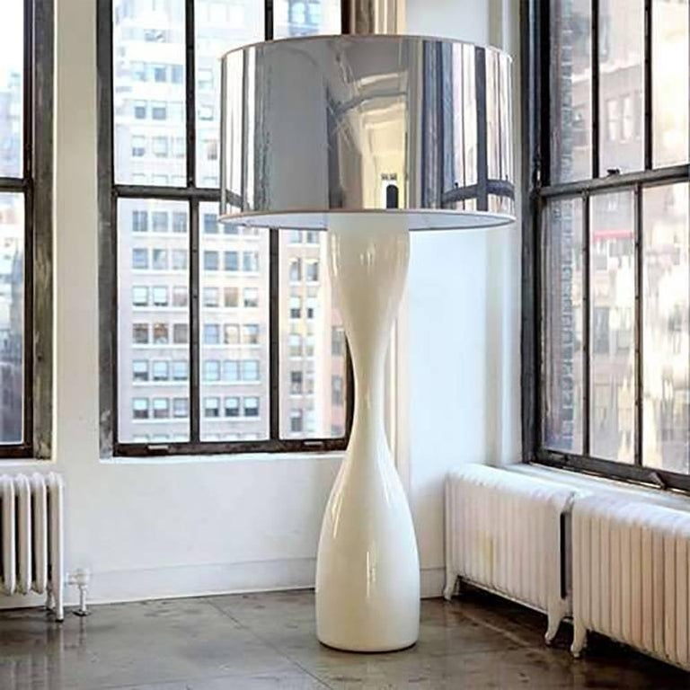 A dramatic and rare pair of monumental Moai floor lamps by Luca Nichetto. Fluid minimalist form and high gloss polyethylene, achieved through rotational molding, create a sleek, elongated hourglass column. The oversized, deep grey mylar drum shade -