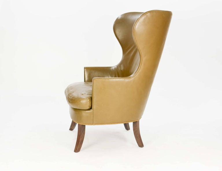 These are our made-to-order wingback club chairs. They are a Danish design, and we can cover them in fabric or leather. The legs, also, can be ebonized or produced in dark walnut. List price does not include upholstery fabric or leather.