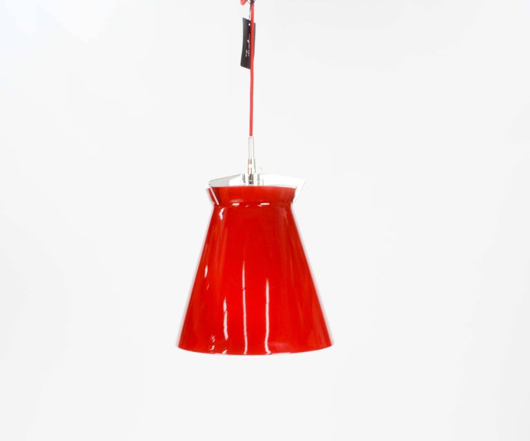 A Pair of Good Seed of Denmark Red Glass Pendant.  The lights feature this wonderful red glass and clamping claw hanger.  They come with a chrome canopy