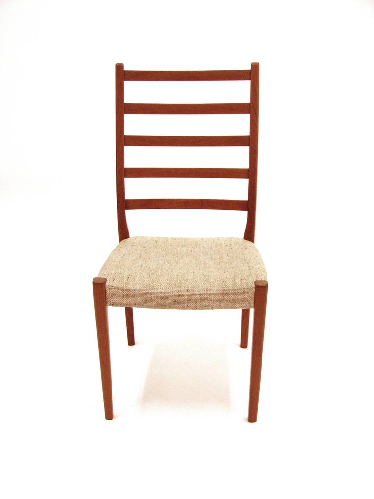 A handsome set of four teak ladder back dining chairs by Svegards Markaryd with original wool weave upholstery.