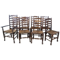 Eight '7 and 1' Antique English Oak Ladder Back Dining Chairs