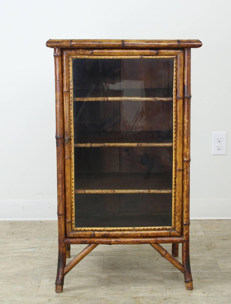 Antique english bamboo cabinet with pressed leather for for Bamboo kitchen cabinets for sale