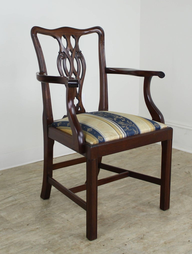 A full set of very handsome fine Chippendale style chairs. Two arms and six sides. The chairs are in a beautiful mahogany with exceptional color and a rich patina. There is some color variation due to light exposure over the years, but all chairs