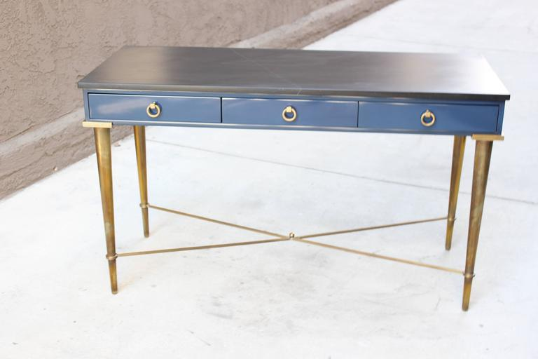 Arturo Pani brass, cadet blue lacquer and slate topped console table with three drawers.