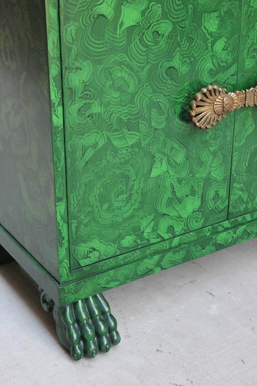 Faux malachite lacquer cabinet with lion paw feet.