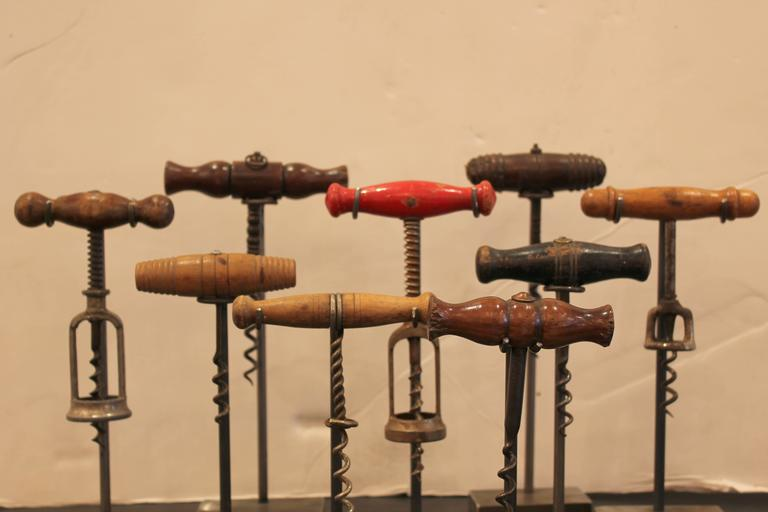 A collection of French corkscrews on stands,  20th century.