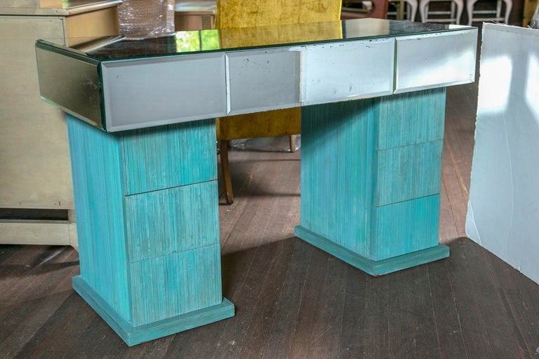 1940s wood and beveled mirror vanity. Three mirrored drawers. Six stacked drawers. Finished on three sides.