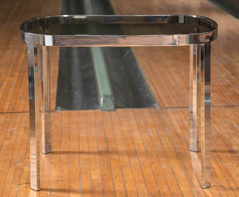 1970s Directional chrome and tinted glass side tables with curved corners.