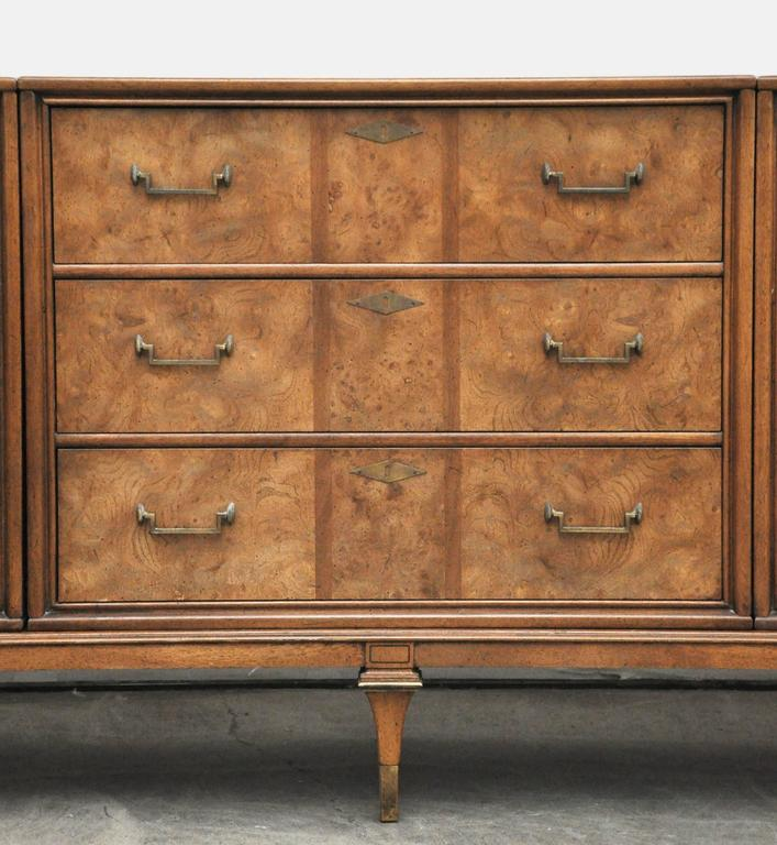 Fine quality Hollywood Regency style Bernhard Rohne for Mastercraft brass and burled wood credenza. Three cabinet pieces on a single plinth base. Beautiful finished back. Total of 11 drawers. Signed Mastercraft.