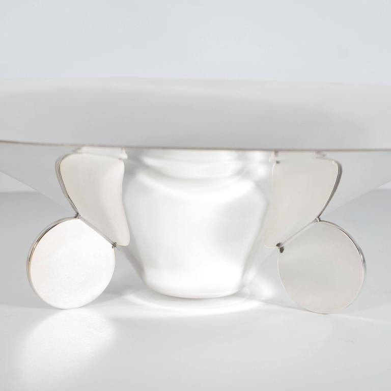 This elegant Art Deco silver plate bowl or dish was realized by the fabled design firm Ikora in Germany circa 1930. It offers a sculptural concave form funnel-shaped dish with a flat bottom is adorned by a trio of flat circular support disks. This
