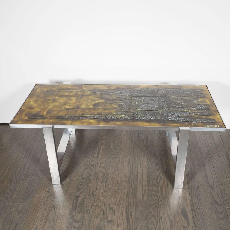 A stunning Mid-Century Modern ceramic tile and polished aluminium coffee table by Juliette Belarti, the tabletop with dark mossy green black brown handcrafted ceramic tiles signed