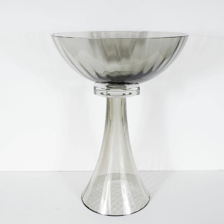 This set of three handblown Murano glass bowls or vases features fluted footing with a tapered neck design in smoked glass. An elegant, clear octagonal glass collar supports a smoked glass bowl with fluted detail. Custom order, 6 week
