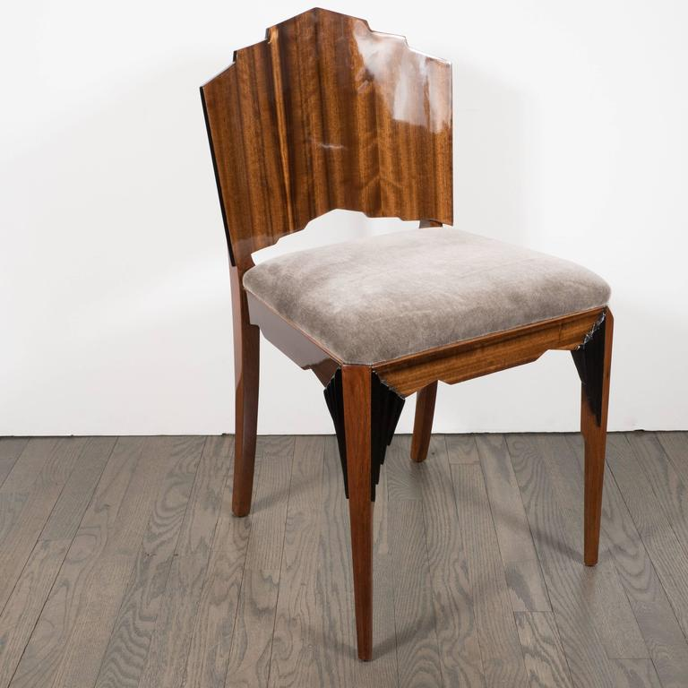 Constructed in the 1930s, this elegant Art Deco chair recalls old world craftsmanship and new world modernity with its skyscraper style tiered back made from beautiful tiger's eye walnut. It features lacquer accents tracing the perimeter of the back