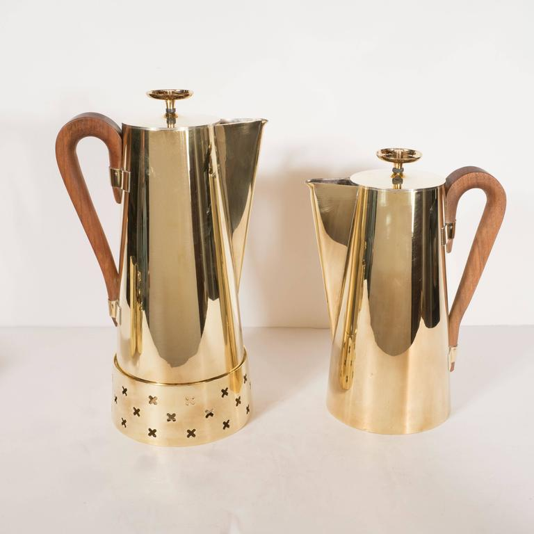 This gorgeous coffee or tea service set was designed by Tommi Parzinger, among the most celebrated Mid-Century Modernist designers, for Dorlyn Silversmiths. The set includes one large coffee pot, one medium tea pot, a creamer, and a sugar bowl with