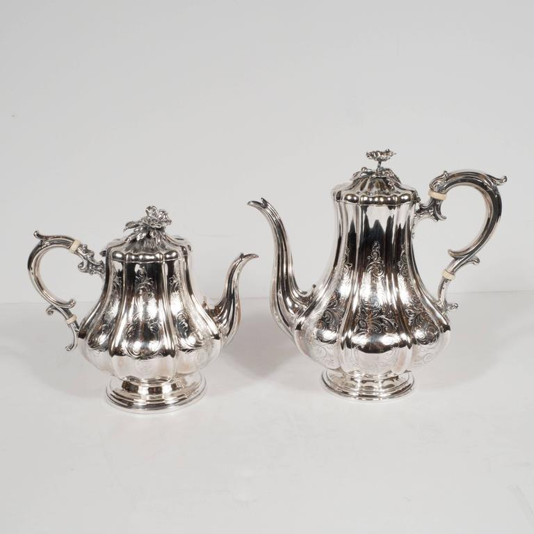 This lustrous six piece coffee/tea service was created circa 1950 by the legendary silversmiths Elkington & Co of Birmingham England. It includes a tray, a samovar, a coffee and tea pot, a sugar bowl, and a cream saucer. While each piece in the