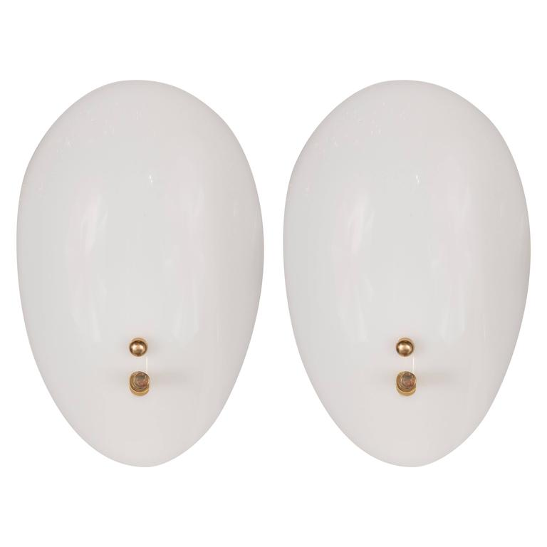 Sophisticated Mid-Century Pair of Ovoid Wall Sconces in Lucite