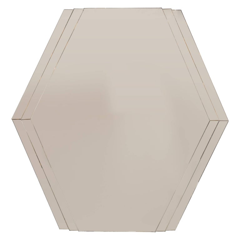 Mid-Century Modernist Hexagonal Mirror with Skyscraper Style Tiered Perimeter For Sale