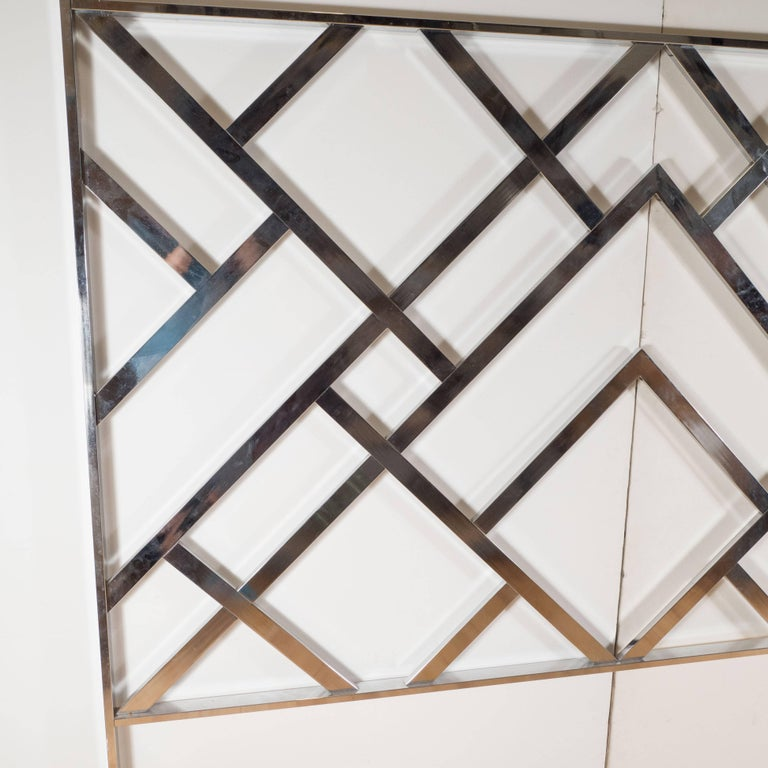 Inspired by Art Deco forms, this sophisticated chrome king-size headboard features a wealth of overlapping geometric forms, which look as contemporary today as they did when it was created some forty five years ago. This headboard would be perfect