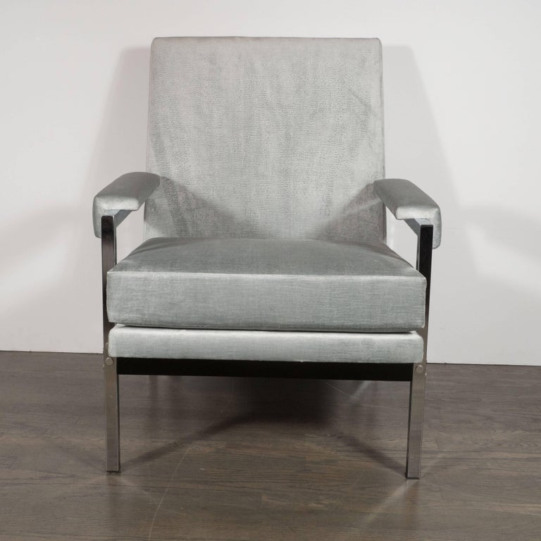 This handsome pair of arm or club chairs exemplify the clean, bold lines that collectors of 1970s American design cherish. They feature two open square sides forged in lustrous chrome connected with an ebonized walnut panel as a back slat. The