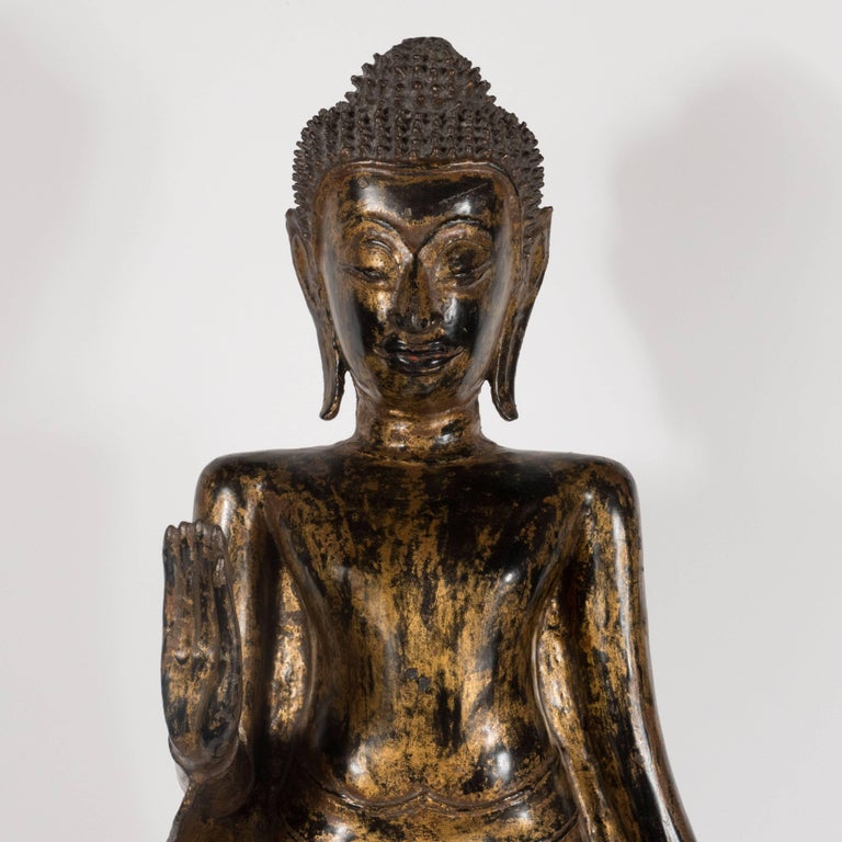 This quietly stunning Buddha was realized in Thailand during the 19th century. It represents an exceptionally fine example of the period. The Buddha wears a long flowing robe. His Ushnisha- or crown of hair- consists of an abundance of small raised