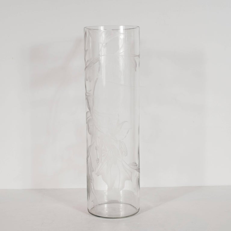 This sophisticated vase was created by Dorothy Thorpe, the acclaimed midcentury glassware designer, in the 1950s. Its understated elegance- consisting of an austere cylindrical form and acid etched maple leaf motif- helps to explain her renown.
