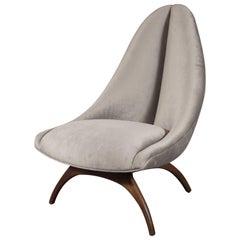 Sculptural Mid-Century Modern Gondola Back Lounge Chair with Walnut Saber Legs