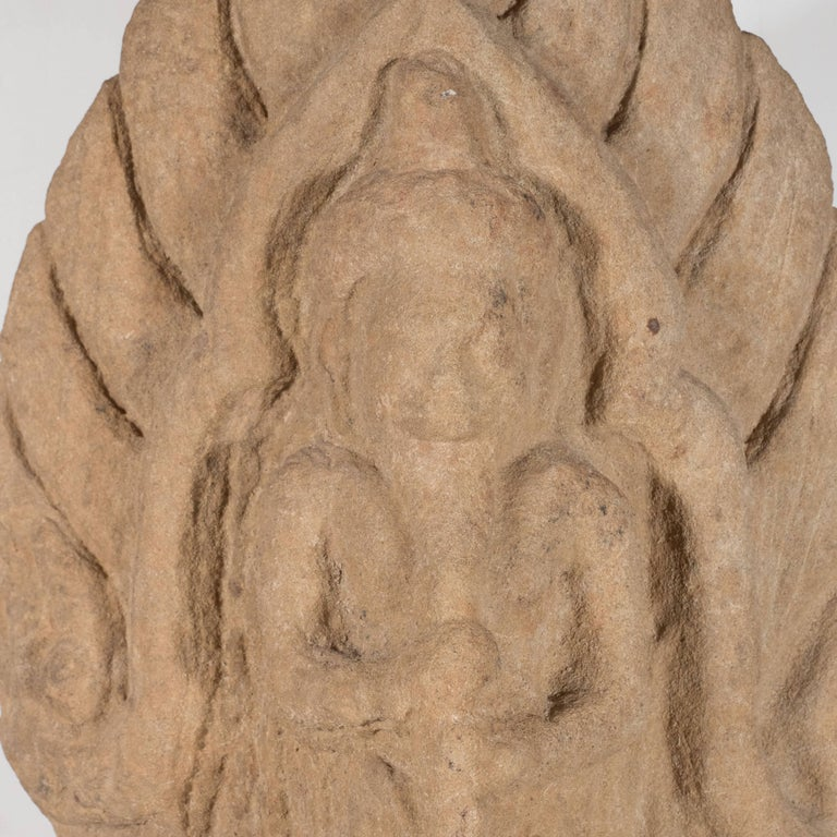 18th Century and Earlier Antique Indian Hand-Carved Limestone Temple God with Lotus Leaf Motif For Sale