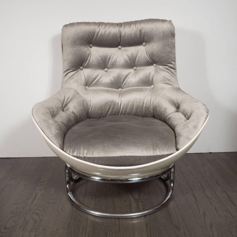 This sophisticated and dynamic pair of lounge chairs was produced by the esteemed French maker Airborne, circa 1970. They feature button back upholstery on every facet of the chair surrounded by lustrous white fiberglass surrounds with piping in the