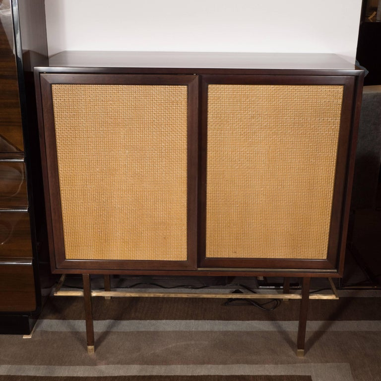 This sophisticated cabinet was designed by Harvey Probber, circa 1960 and handmade in Fall River, Massachusetts. Probber was celebrated with his austere and elegant designs, creating furniture with the belief that