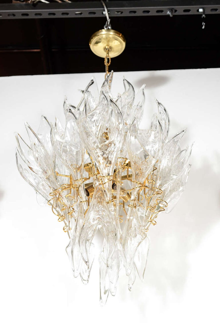 This striking and graphic Mid-Century Modern chandelier was realized by the illustrious Italian glass studio, Mazzega, in Murano, circa 1970. The chandelier offers an abundance of unique handblown Murano glass translucent shades- resembling stylized