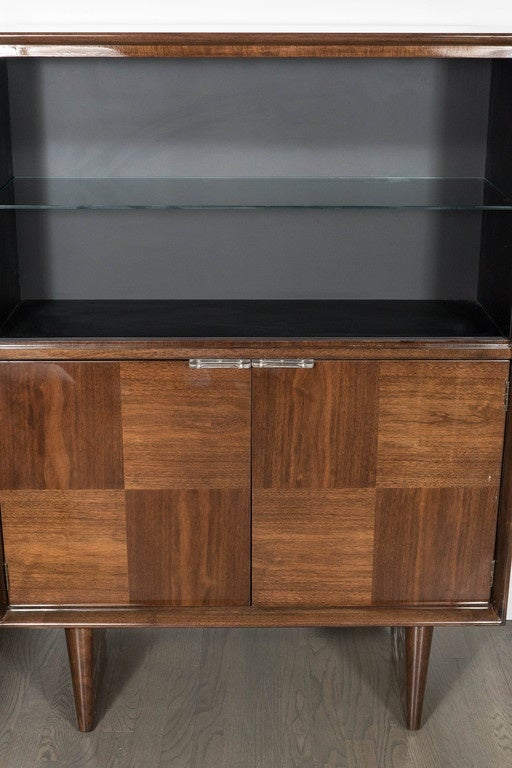 This rare and exceptional Mid-Century Modern cabinet was designed by Gilbert Rohde for Herman Miller, circa 1944. Gilbert Rohde's designs represent the bridge between Art Deco and Mid Century Modernism in America. Combining classic, yet forward