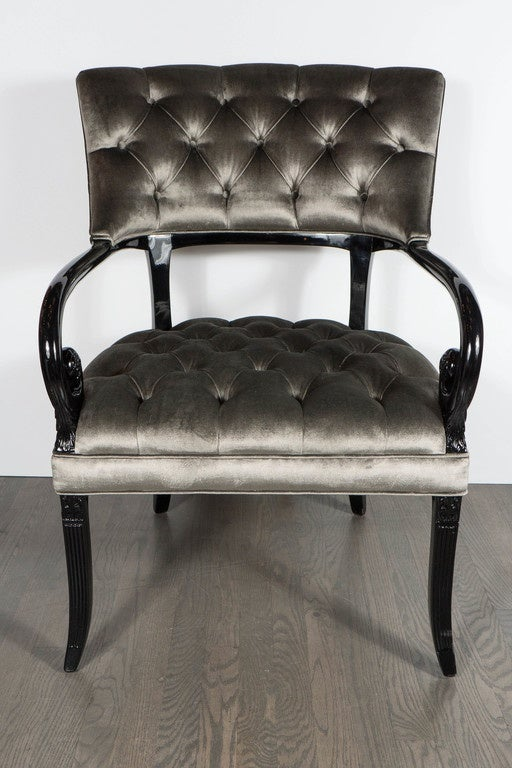 This pair of elegant Hollywood Regency scroll occasional chairs by Grosfeld House features a scroll arm design and splayed tapered legs in ebonized walnut. The chairs feature tufted detailing on the seat and back, and have been newly upholstered in