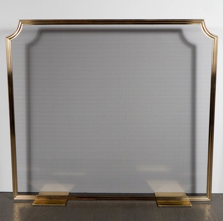This custom-made fire screen features a lightweight design with a slimline polished brass frame and mesh with truncated corners for added style. It has flat supports so the view is unobstructed. This design is customizable, you can choose the size