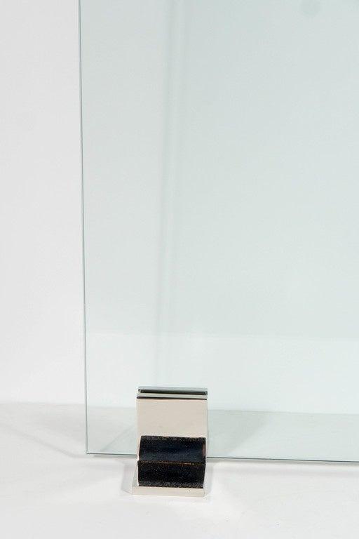 This custom fire screen features a frameless pane of ½