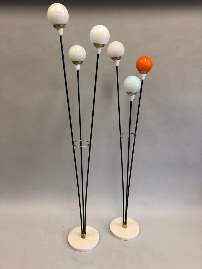 Complimentary pair of Italian Mid-Century Modern floor lamps titled