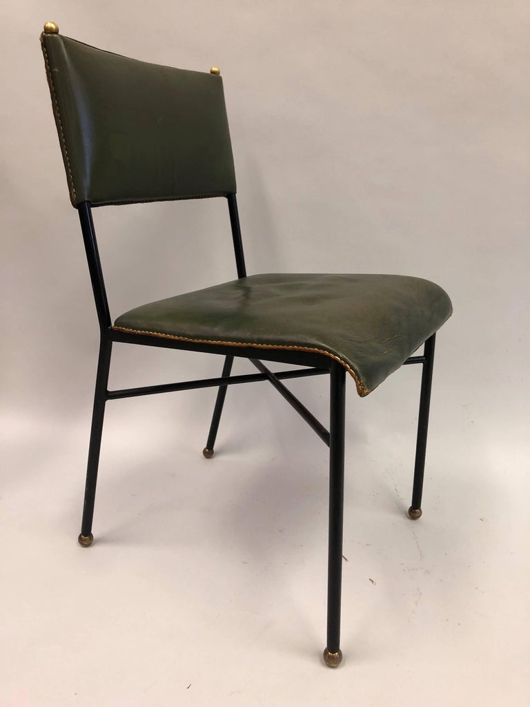 Elegant French Mid-Century Modern hand-stitched leather desk chair by Jacques Adnet.