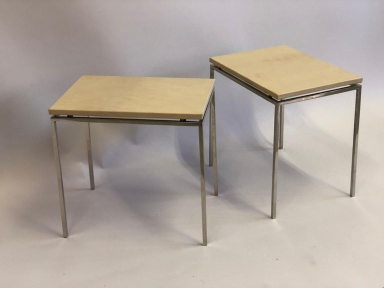 Elegant pair of French Mid-Century Modern cantilevered nickel and parchment leather side / end tables / gueridon attributed to Maison Ramsay.   The pieces feature delicate nickel metal frames with tops of parchment leather cantilevered above them.