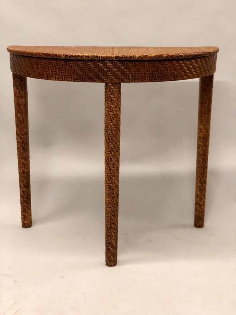 Elegant, sober Italian Mid-Century Modern console or sofa table in rattan / wicker stitched in an interwoven geometric pattern.   References: Bamboo.