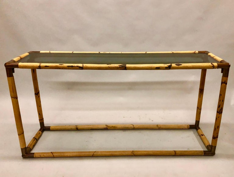 2 elegant Italian Mid-Century Modern bamboo / rattan and glass consoles or sofa tables by Giovanni Banci. Original smoked glass top accompany the pieces.