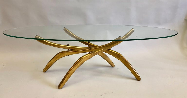 Important Italian Prototype Cocktail table Attributed to Carlo Mollino carved from wood and gilt to resemble metal. The table legs and spine resemble an insect such as an arachnid / spider. While maintaining a distinct modern look and feel.   The