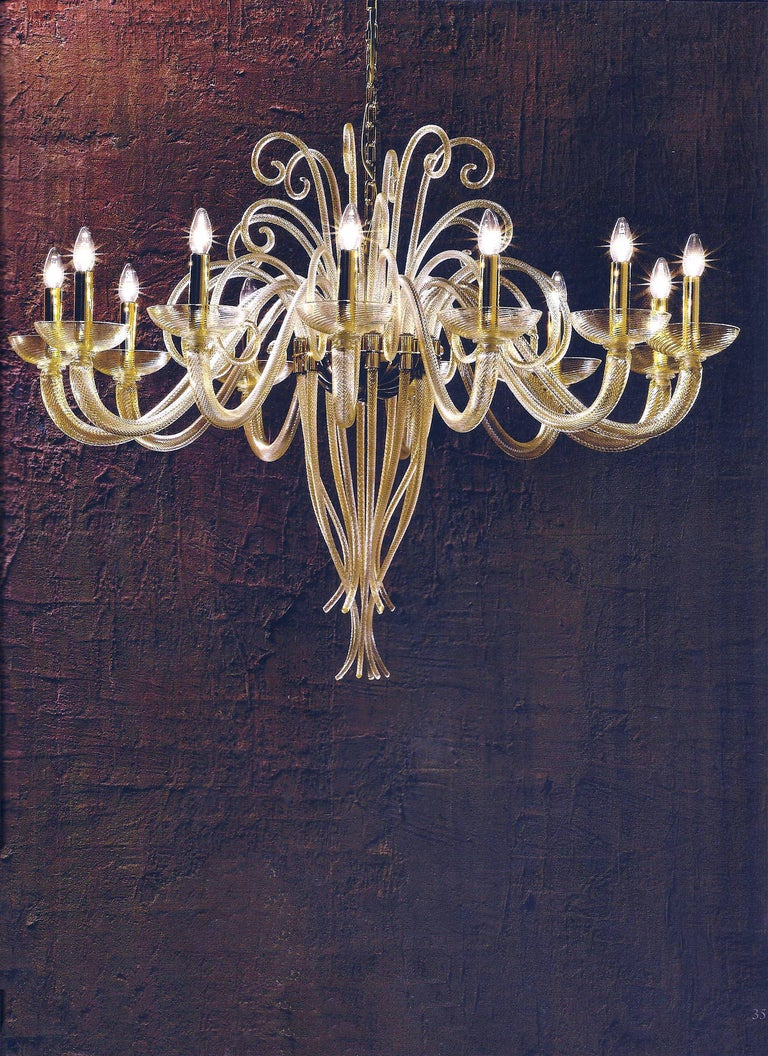 A stunning Italian midcentury style Venetian glass chandelier/pendant in gold glass. The piece evokes an ethereal presence of a poetic bouquet of flowers, with a harmonious sense of flow and balance.  This modern traditional piece can also be